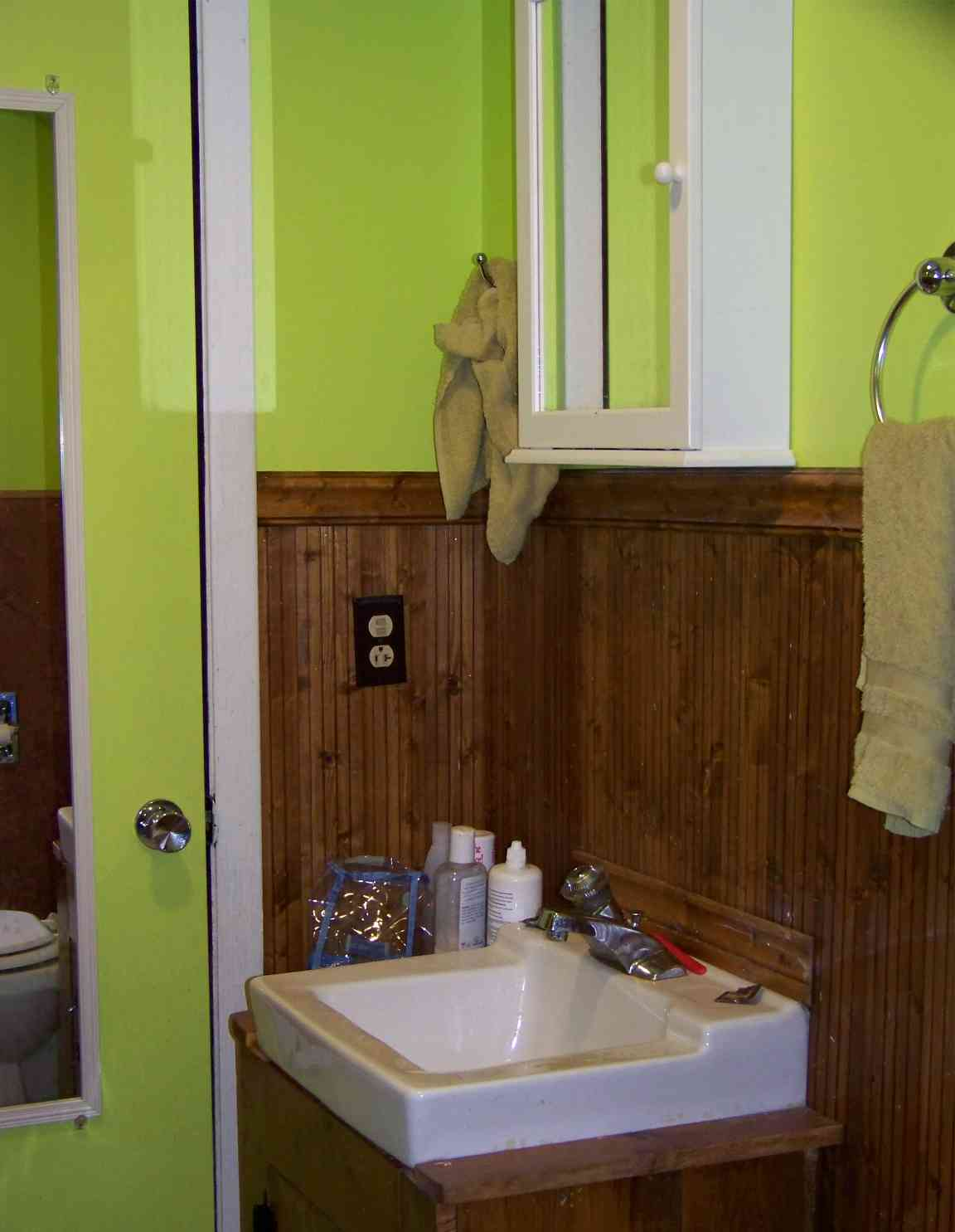 Bathrom is recently redone with high-end flooring and cheerful colors