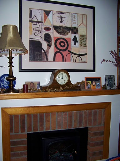 A cozy faux fireplace and mantel