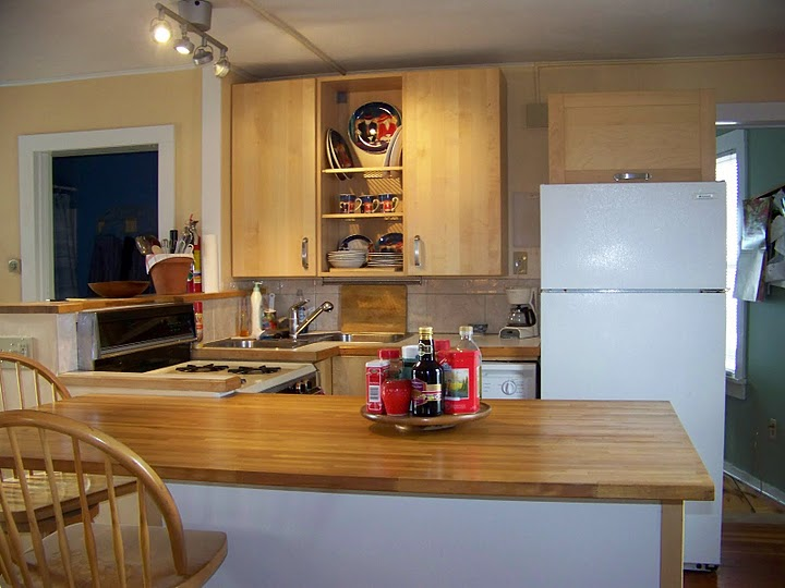 The cheerful kitchen has a gas stove and a dishwasher