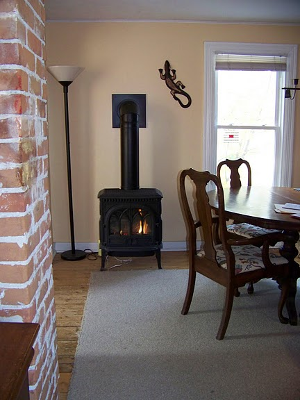 The energy-efficient gas stove looks like a wood stove and is great for cozy winter days