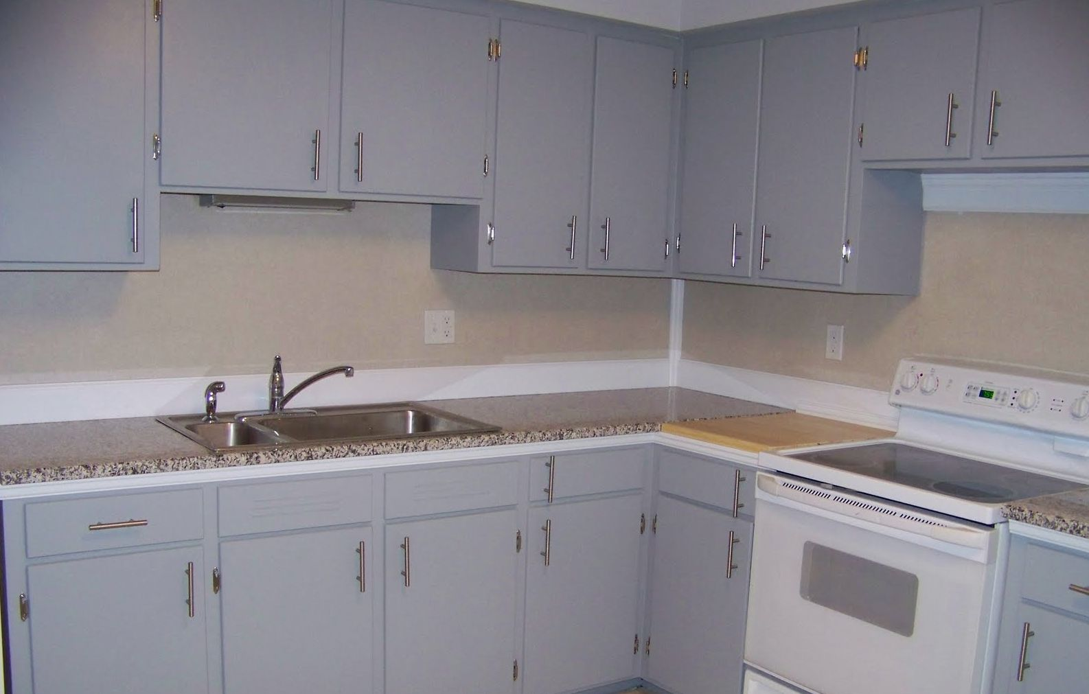 White kitchen cabinets with brushed nickel hardware for Kitchen cabinets hardware