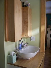 The stylish bathroom has a lot of storage