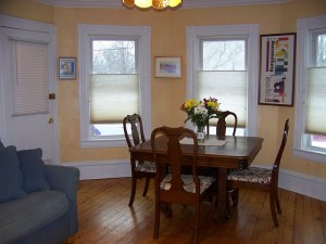 The sunny front room can be used as a dining room, den, or master bedroom - your choice!